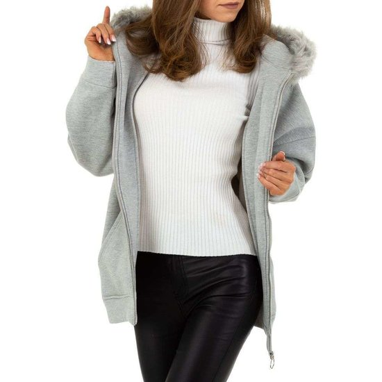 Sweater oversized gris.