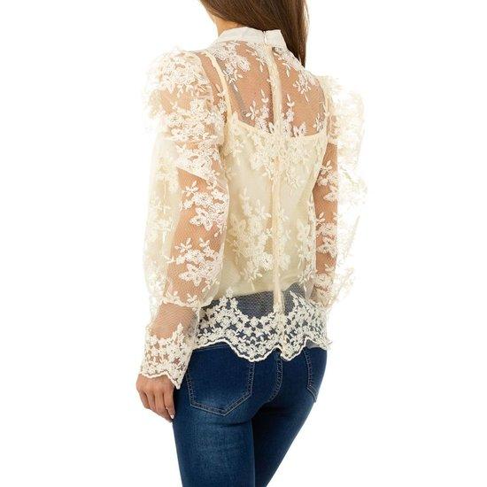 Chique cremekleurige blouse met strik.