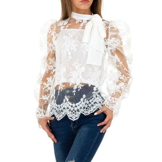 Chique witte blouse met strik.