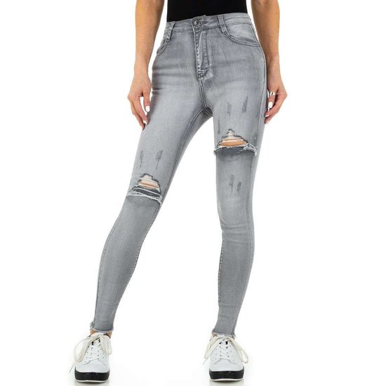 Trendy grijze destroyed jeans.