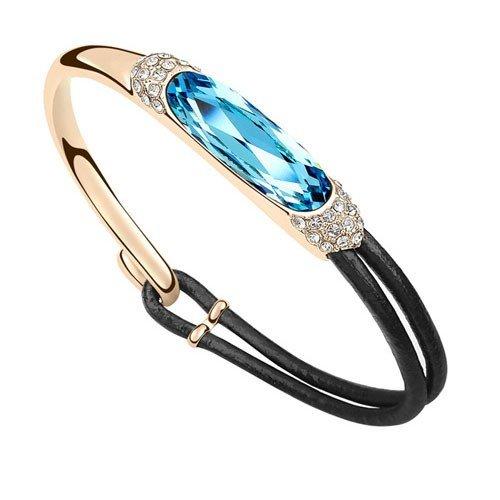 Luxe gouden fashion armband met blauwe edelsteen.