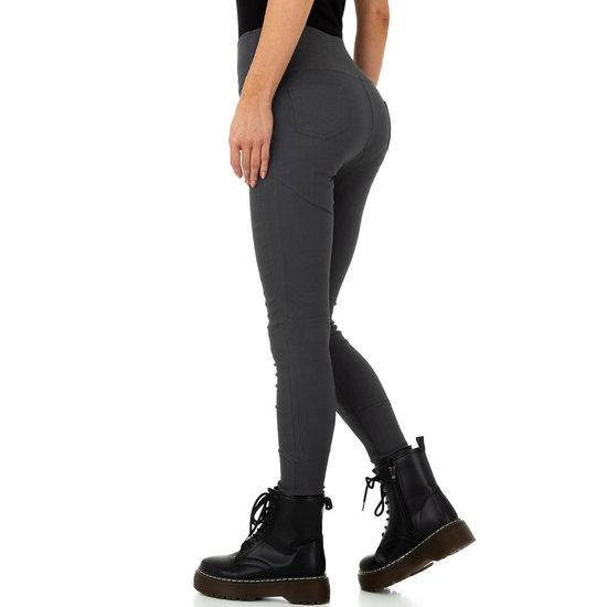 Skinny aanpassende grijze hoge taille broek.