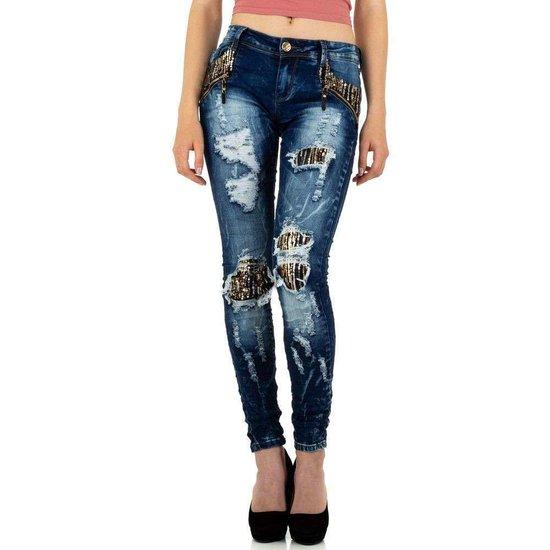 Fashion destroyed jeans met gouden accenten.
