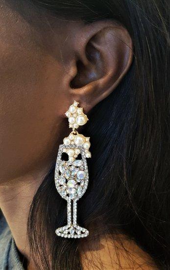 Goud/witte oorbellen vorm champagneglas.