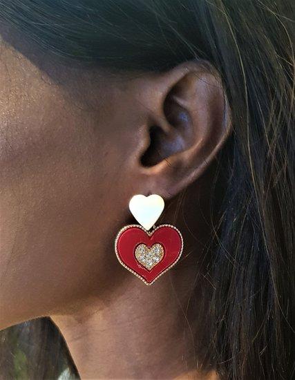 Classy rood/gouden oorbellen,hart in hart.