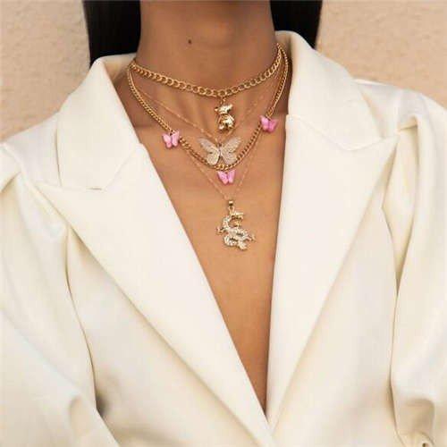 Trendy 4 lagige gouden halsketting met vlinders.