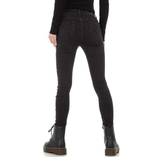 Zwarte skinny jeans met snake print deco lijn.