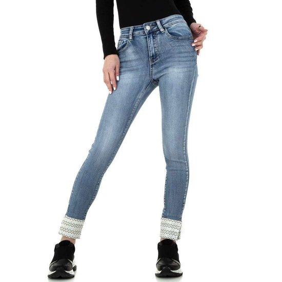 Skinny blue jeans met applicatie.
