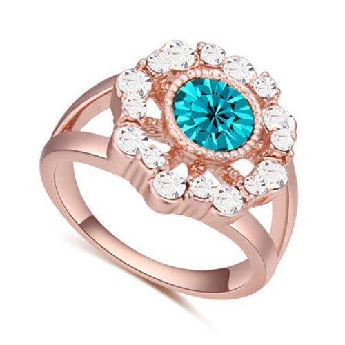 Classy rose goldplated ring met blauwe-witte bergkristallen.
