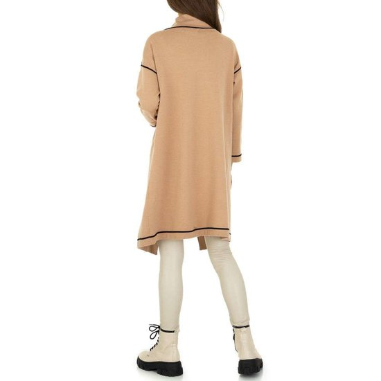 Beige oversized midi cardigan.