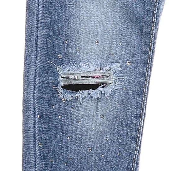 Trendy blauwe meisjes jeans destroyed.