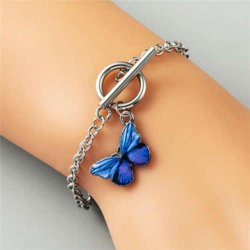 Zilveren armband met donker blauwe vlinder.