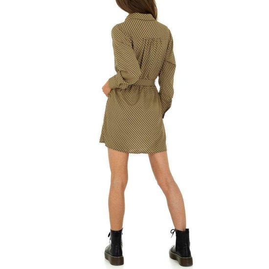 Modieuze korte groene blouse jurk.