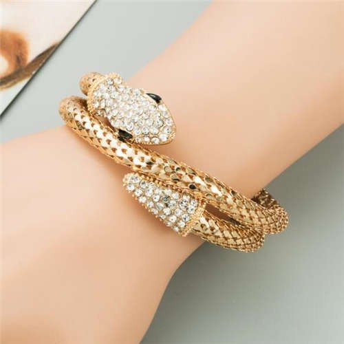 Fashion gouden snake armband met witte strass.