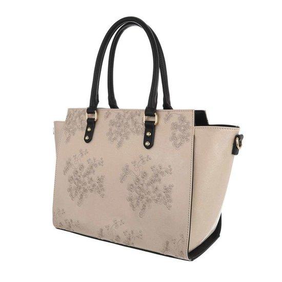 Trendy beige shopperbag met decoratie.