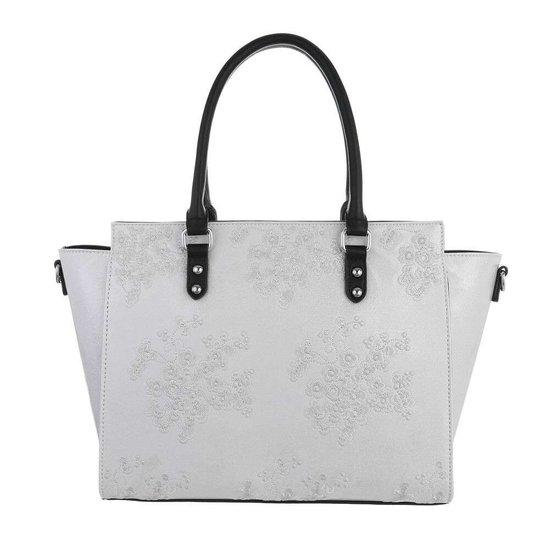 Trendy witte shopperbag met decoratie.