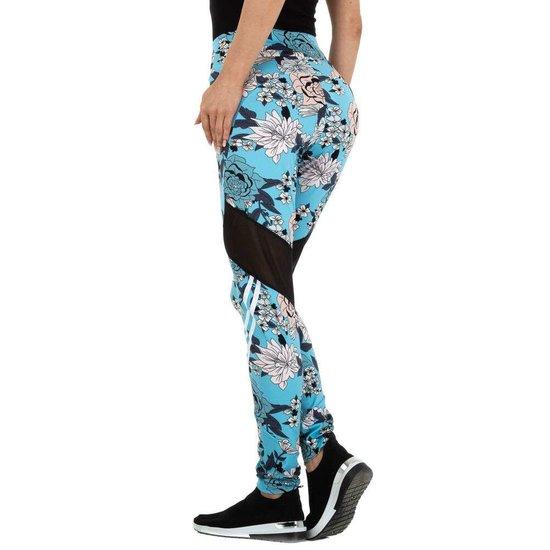 Trendy blauwe legging met floral motief.
