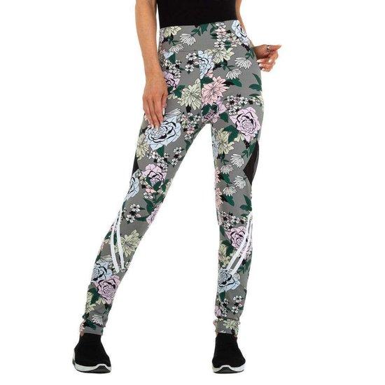 Trendy grijze legging met floral motief.