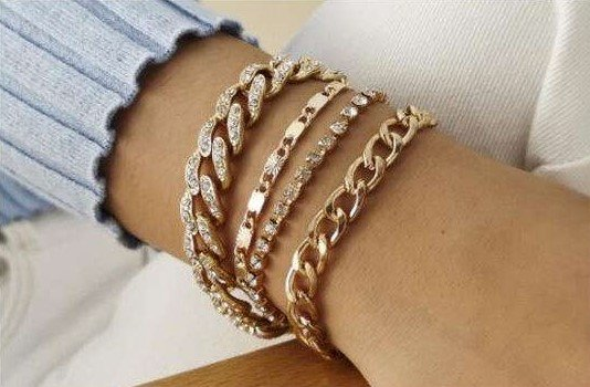 Modieuze 4 delige gouden-zilveren armband.