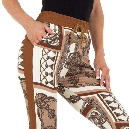 Bruine mix legging met barok motief.