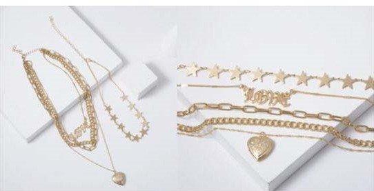 5 delige gouden-zilveren halsketting.