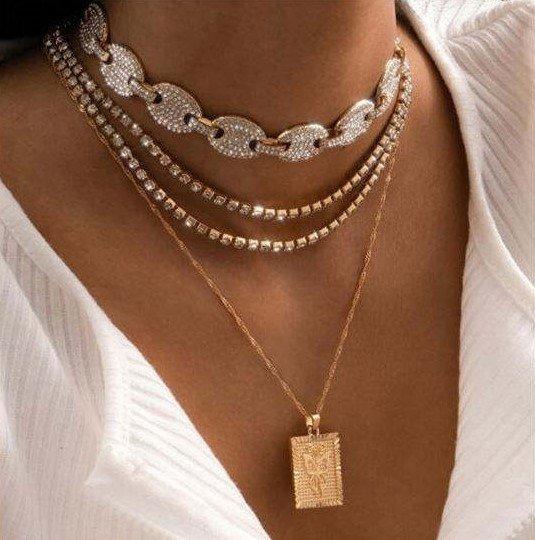 4 delige gouden-zilveren halsketting.