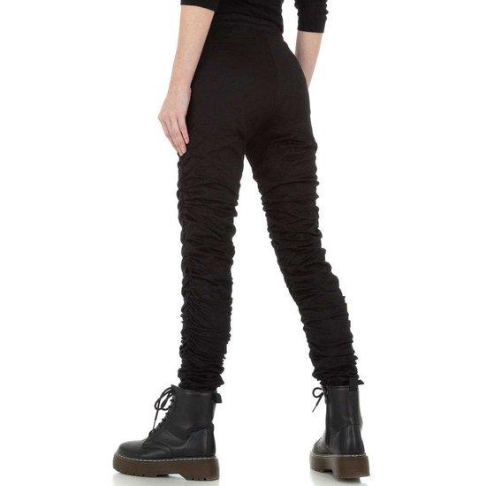 Skinny zwarte gefronste jeans broek.