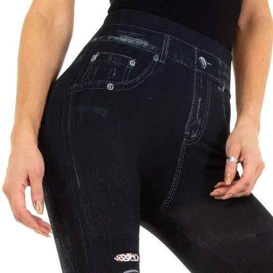 Zwarte-beige legging in jeans destroyed look.