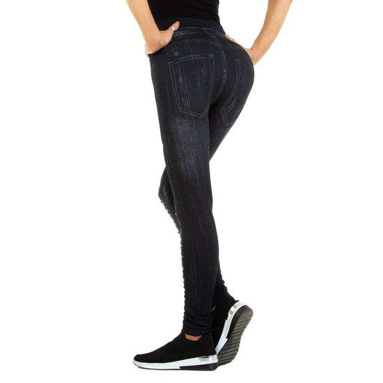 Zwarte-bruine legging in jeans destroyed look.