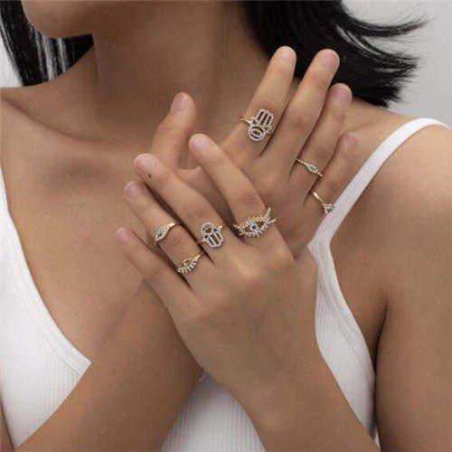 7 delige gouden luxe ringenset,handen en ogen.