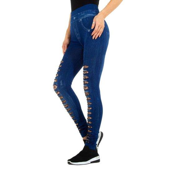 Blauwe-bruine legging in jeans destroyed look.