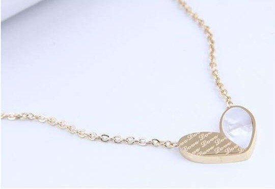 Titanium gouden halsketting met harten.