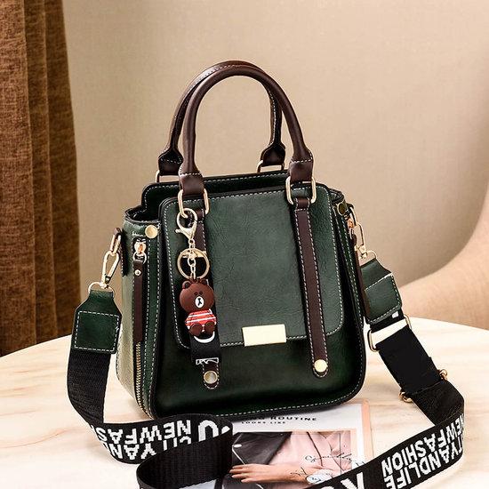 Handtas met trendy riem