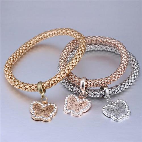 Fashion trio armbanden met vlindermotief.